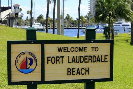FORT LAUDERDALE, FLORIDA - FEBRUARY 3  Welcome to Fort Lauderdale Beach sign in Merle Fogg   Idlewyld park near Las Olas Intracoastal waterway drawbridge on February 3, 2013 in Ft Lauderdale, Florida