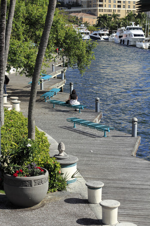 ft lauderdale: FORT LAUDERDALE, FLORIDA - FEBRUARY 3  Boats moored and people relaxing and walking along the wooden walkway at the Riverwalk beside the New River on February 3, 2013 in Ft Lauderdale, Florida