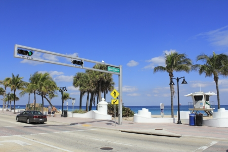intersects: FORT LAUDERDALE, FLORIDA - MARCH 3, 2013  View from across the street of the opening to Sebastian beach at the end of Sebastian Street where it intersects with State Road A1A on a sunny day in winter