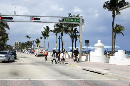 FORT LAUDERDALE, FLORIDA - APRIL 6, 2013  Many people walking, biking and enjoying the Atlantic beach coast on a partly sunny day in tropical south Florida near Terramar Street and State Road A1A