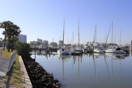 jacks: SARASOTA, FLORIDA - MAY 9, 2013  Many small boats and yachts moored to docks in Sarasota Bay Marina along Bayfront Drive north of Marina Jacks near downtown Sarasota, Florida on a sunny morning  Editorial