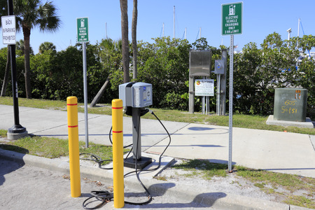 enabled: SARASOTA, FLORIDA - MAY 9, 2013  Liberty enabled, Clipper Creek electric vehicle charging station with a 3 hour limit off Bayfront Avenue in parking area near Marina Jacks harbor and Sarasota Bay