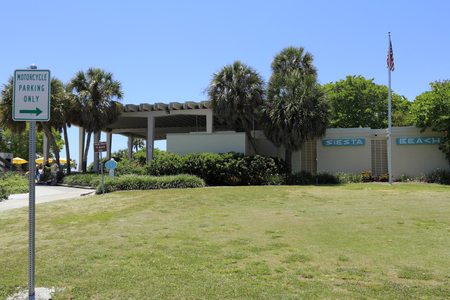 rentals: SIESTA KEY, FLORIDA - MAY 9, 2013  Building at the entrance to Siesta Beach that contains a recreation equipment rentals, a place to buy prepared food, places to eat in the shade, restrooms and more  Editorial