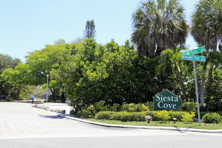priced: SIESTA KEY, FLORIDA - MAY 9, 2013  Siesta Cove neighborhood sign  Siesta Cove is a residential community filled with many luxury, high priced homes in a beautiful tropical location