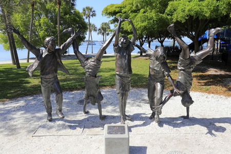 SARASOTA, FLORIDA - MAY 9, 2013  Bronze metal sculpture of five children being carefree in Sarasota Bayfront park by sculptor Glenna Goodacre that was given by community friends to City of Sarasota  Stock Photo - 26089991