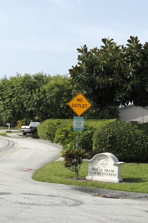 OAKLAND PARK, FLORIDA - JULY 1, 2013  Entrance welcome sign of the relaxing suburban neighborhood of Royal Palm Lake Estates  105 homes are in this residential subdivision located in Broward County