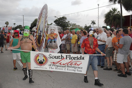 WILTON MANORS, FLORIDA - JUNE 22, 2013  Many South Florida Sisters of Perpetual Indulgence of the House of the Rising Sun marching in the annual gay pride parade on Wilton Drive in the early evening