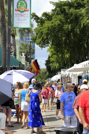 FORT LAUDERDALE, FLORIDA - MARCH 2, 2014  Many people peruse the large variety of art for sale at the weekend long Las Olas Boulevard art fair and festival downtown on a sunny and tropical day