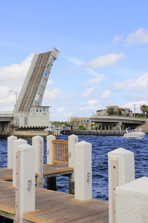 POMPANO BEACH, FLORIDA - FEBRUARY 12, 2014  Raised up Hillsboro Inlet Draw Bridge in Hillsboro Mile with a boat that just passed under it coming from the Intracoastal Waterway to the Atlantic Ocean