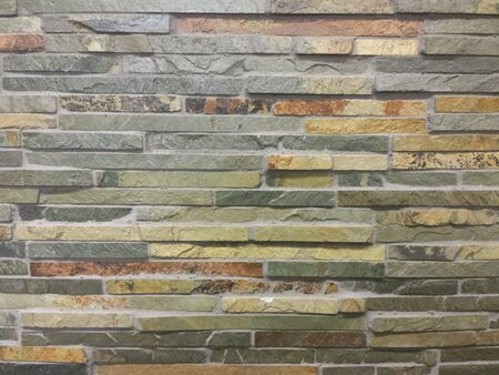 fused: Slate Wall .  Thin pieces of multicolor, rectangular slate stone fused together horizontal Stock Photo