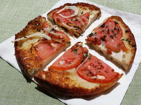 Tomato Onion Shicaccia. Small,  personal size round pizza like food. Stock Photo