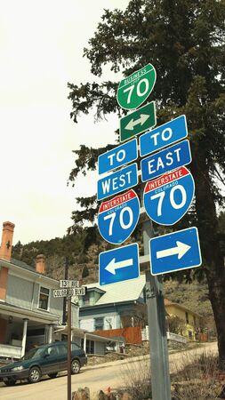 Highway I-70 signs in Idaho Springs, Colorado  Banco de Imagens