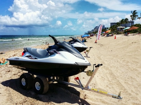 rentals: WaveRunner watercraft for rent with sign, Banana Boats, on Fort Lauderdale, Florida beach