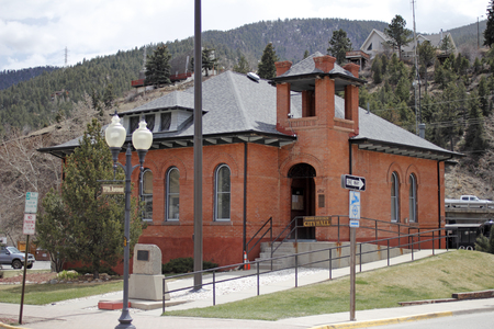pepsico: Idaho Springs, CO, USA - April 19, 2014: Front and side view of a brick city hall building with bell tower at 1711 Miner Street in downtown. Brick City Hall building with ramp walkway, parking, Highway 70, homes and evergreen tree covered mountains in the