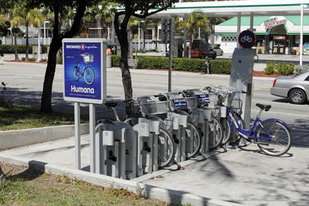 ft lauderdale: Fort Lauderdale, FL, USA - JUNE 25, 2014: Broward B-Cycle Station located at A1A just south of Oakland Park Boulevard. A collection of public bicycles for rent located in a kiosk on the east side of State Route A1A on a sunny day. Editorial