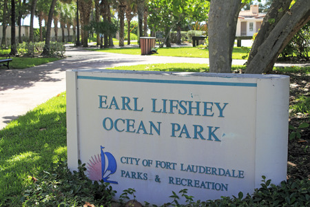 east end: Fort Lauderdale, FL, USA - June 25, 2014: Entrance sign to Earl Lifshey Ocean Park located past the east end of Oakland Park Boulevard. The shady park with lots of palm trees and native foliage has a walkway that leads to an Atlantic Ocean beach.