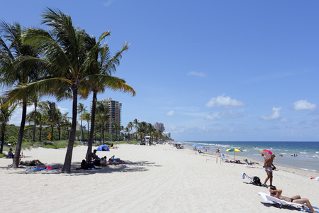 ft lauderdale: Fort Lauderdale, FL, USA - July 12, 2014: Men and women play and enjoy themselves on the beach in the tropical sunshine of Ft. Lauderdale Florida.