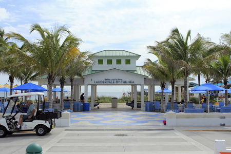 east end: Lauderdale-By-The-Sea, FL, USA - September 20, 2014:  A view of the modern pavilion at the east end of Commercial Boulevard. People gather at a large beach pavilion Editorial