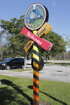 railroad crossing: Fort Lauderdale, FL, USA - November 30, 2014: Railroad crossing shape sign welcoming people to the Junior League Play Station Fun Zone. Junior League Play Station Fun Zone entrance sign. Editorial