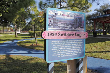 switcher: Fort Lauderdale, FL, USA - November 30, 2014: An informational sign about the historic Switcher Engine located in Holiday Park. 1936 Switcher Engine sign in Holiday Park.