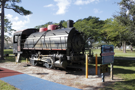 switcher: Fort Lauderdale, FL, USA - November 30, 2014: Front side view of an historic locomotive 1936 Switcher Engine and informational sign. 1936 Switcher Engine in Holiday Park.