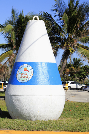 incorporated: Dania Beach, FL, USA - December 7, 2014: One very large cement buoy with a sign on it that says Broward s First City, Dania Beach, Incorporated 1904. A large buoy at a park entrance Editorial