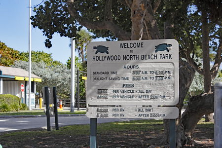 fl: Hollywood, FL, USA - December 7, 2014: Large sign welcoming visitors to Hollywood North Beach Park. The large welcome sign also lists hours and parking fees. Editorial