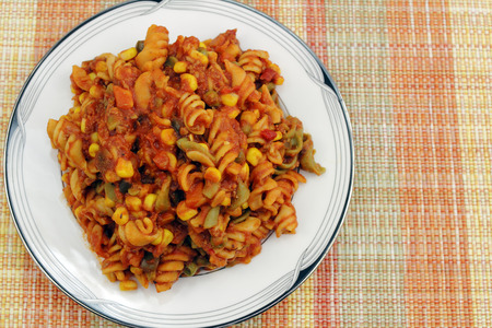 tricolor: Cooked tri-color rotini spiral pasta made with spinach, tomatoes and carrot, mixed with sweet corn, green and red sweet bell pepper, carrots and green beans.