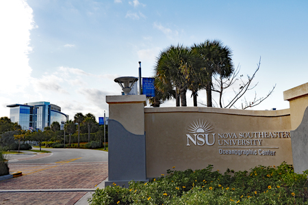 oceanographic: Dania Beach, FL, USA - December 20, 2014: NSU Nova Southeastern University Oceanographic Center entrance, signs and building. NSU is located at 8000 N Ocean Drive.
