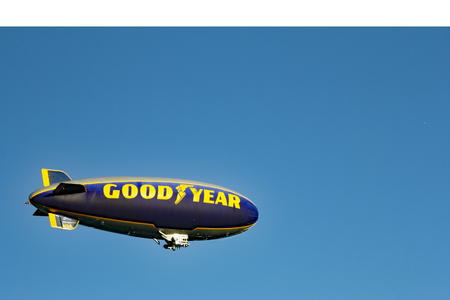 blimp: Hollywood, FL, USA - December 14, 2014: One Goodyear blimp flying in the sky in Hollywood, Florida. An airship in the sky with the words Good Year written on its side.