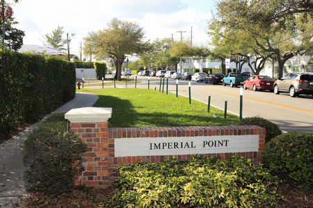 entrance sign: Fort Lauderdale, FL, USA - January 22, 2015: Brick Imperial Point neighborhood entrance sign on NE 62nd Street during the day. Imperial Point entrance sign