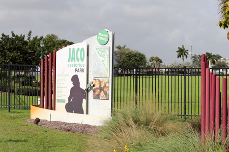 informative: Oakland Park, FL, USA - December 23, 2015: Informative entrance gate sign to a large grass field Jaco Pastorius Park in Oakland Park. Large Jaco Pastorius Park sign