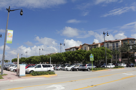 fl: Lauderdale-by-the-Sea, FL, USA - May 16, 2015: Large public parking lot in downtown Lauderdale-by-the-Sea, Florida near the Town Hall and El Prado Park on a sunny day.