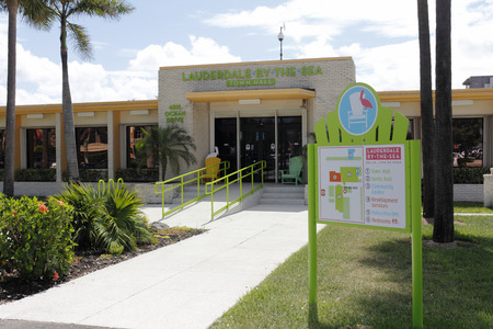 local government: Lauderdale-by-the-Sea, FL, USA - May 16, 2015: Lauderdale-by-the-Sea Town Hall building front with map of the area buildings. Lauderdale by the Sea Town Hall.