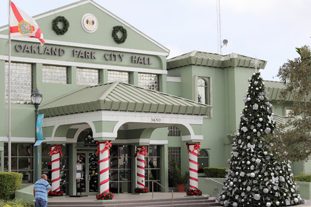 evergreen wreaths: Oakland Park, FL, USA - December 23, 2015: Oakland Park City Hall decorated for Christmas trees and more. Town hall building decorated for the winter holiday season