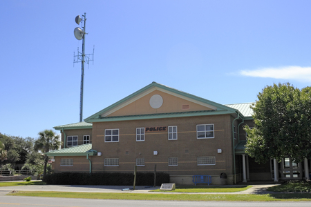 nc: Oak Island, NC, USA - September 29, 2015: Oak Island Police station located on the left side of the building that also houses the Town Hall. A large police station in the day