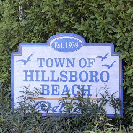 established: Hillsboro Beach, FL, USA - February 12, 2014: Established 1939, Town of Hillsboro Beach decorated sign welcoming people to this small community located in Broward County. Small road sign welcoming visitors to the Town of Hillsboro Beach. Editorial