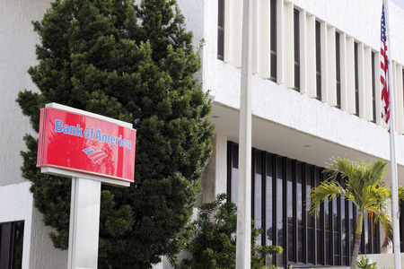 red america: Fort Lauderdale, FL, USA - April 24, 2016: Red, blue and white Bank of America sign in front of the branches location. Bank of America first floor location with sign.