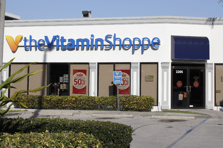 shoppe: Fort Lauderdale, FL, USA - April 26, 2016: Front of the Vitamin Shoppe retail shop on a sunny day. Facade of the Vitamin Shoppe store with a parking lot in front