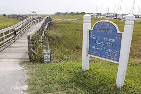 Southport, NC, USA - July 28, 2014: Southport Salt Marsh Boardwalk and Waterway Overlook entry sign. Southport Salt Marsh Boardwalk and Waterway Overlook. Editorial