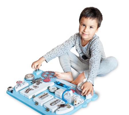 cute toddler baby playing with busy board at home. busy-board for For children. childrens educational toys. Wooden game board. DIY busyboard. isolated on a white background.