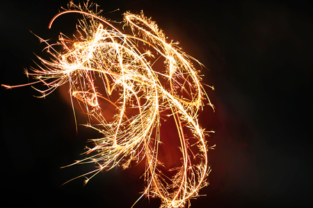 Burning Sparklers in blurred motion. Christmas New Year and Independence Day celebration lights. Bengal fire on empty background Stock Photo