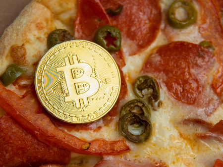 Bitcoin Pizza Day 22 May. concept of buying pizza with bitcoin. cryptocommunity holiday. copy space. 2 pizzas for a price of 10000 Bitcoins. Pizza Index