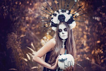 Closeup portrait of Calavera Catrina in black dress. Sugar skull makeup. Dia de los muertos. Day of The Dead. Halloween.