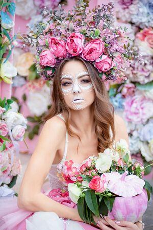 Closeup portrait of Calavera Catrina in pink dress. Sugar skull makeup. Dia de los muertos. Day of The Dead. Halloween. Stock Photo