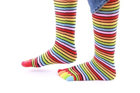 woman legs in strip sock on white background photo