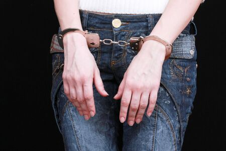 handcuffs on hands photo