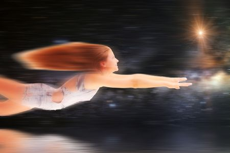 Young woman flying in fantasy world photo