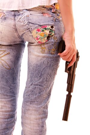 Woman ass and pistol in hands isolated on white Stock Photo - 6152635