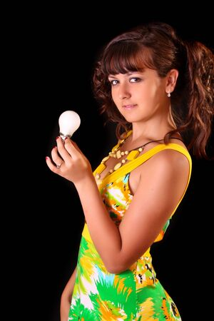 Young woman with lamp tube on black background photo